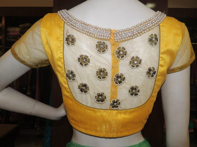 Yellow colour designed blouse with netted covered neck.