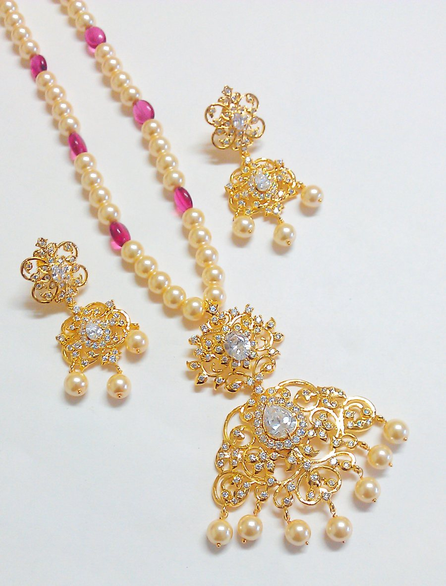 Exclusive uncut polki locket set with pearls mala ..
