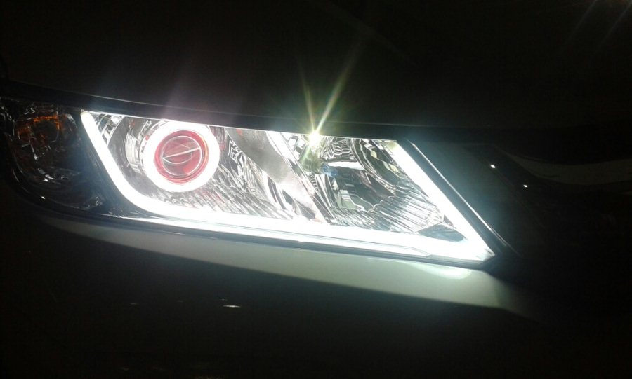 The all new hondacity 2014 headlights remodelled with projectors and HIDs with flexible DRL.