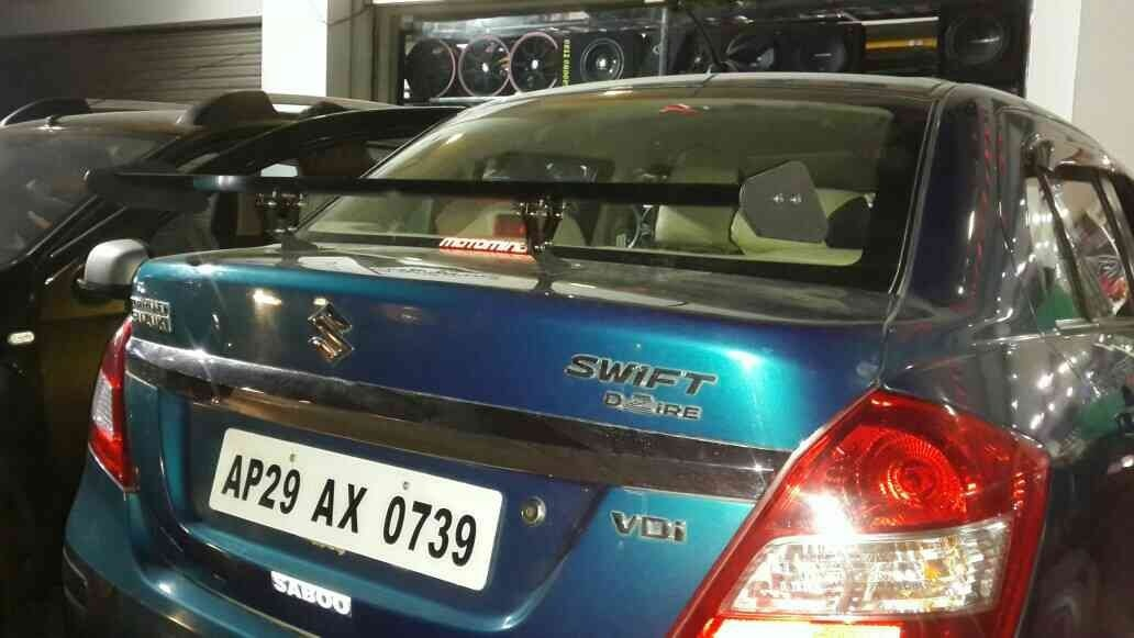 Sports type metal spoilers available  for all cars for better handling of ur car in high speeds and appearance @ motominds