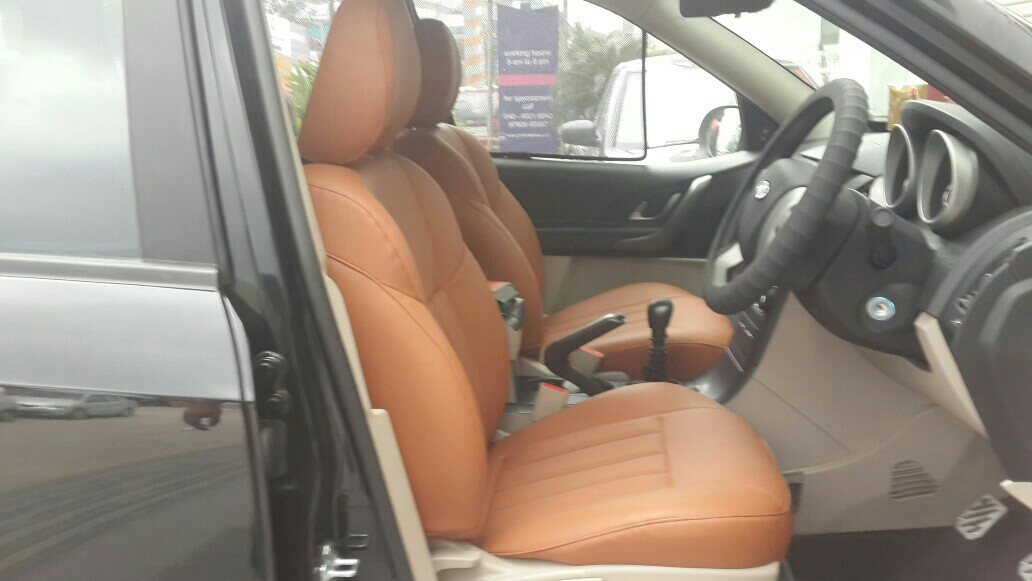 The all new xuv 500 2015 with dark tan seatcovers custom made at motomind....