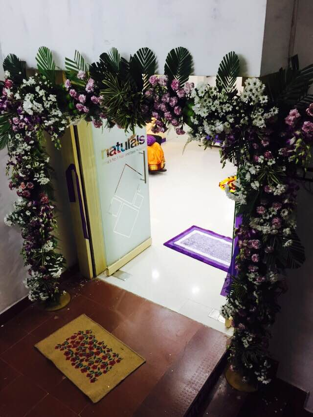 entrance arch with orchids and carnation flowers