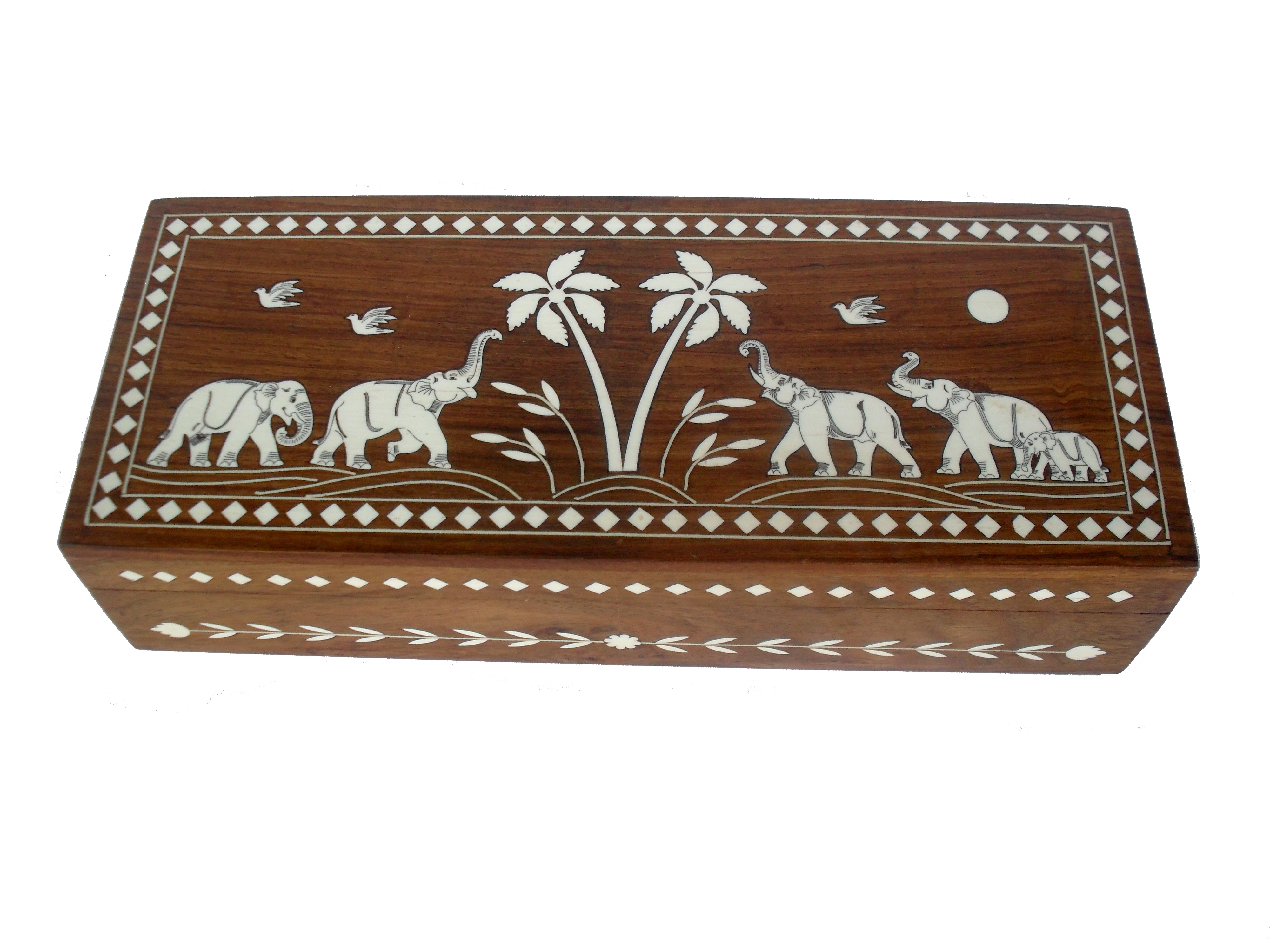 Sheela's decorative rectangular box is  handicrfted with teak wood, adorned a beautiful trees & elephant picture with white inlay on the top of the box.This trinkate box is use to store your delicate jewellery, marble collection , deck of cards, charms and any other items of value to you.