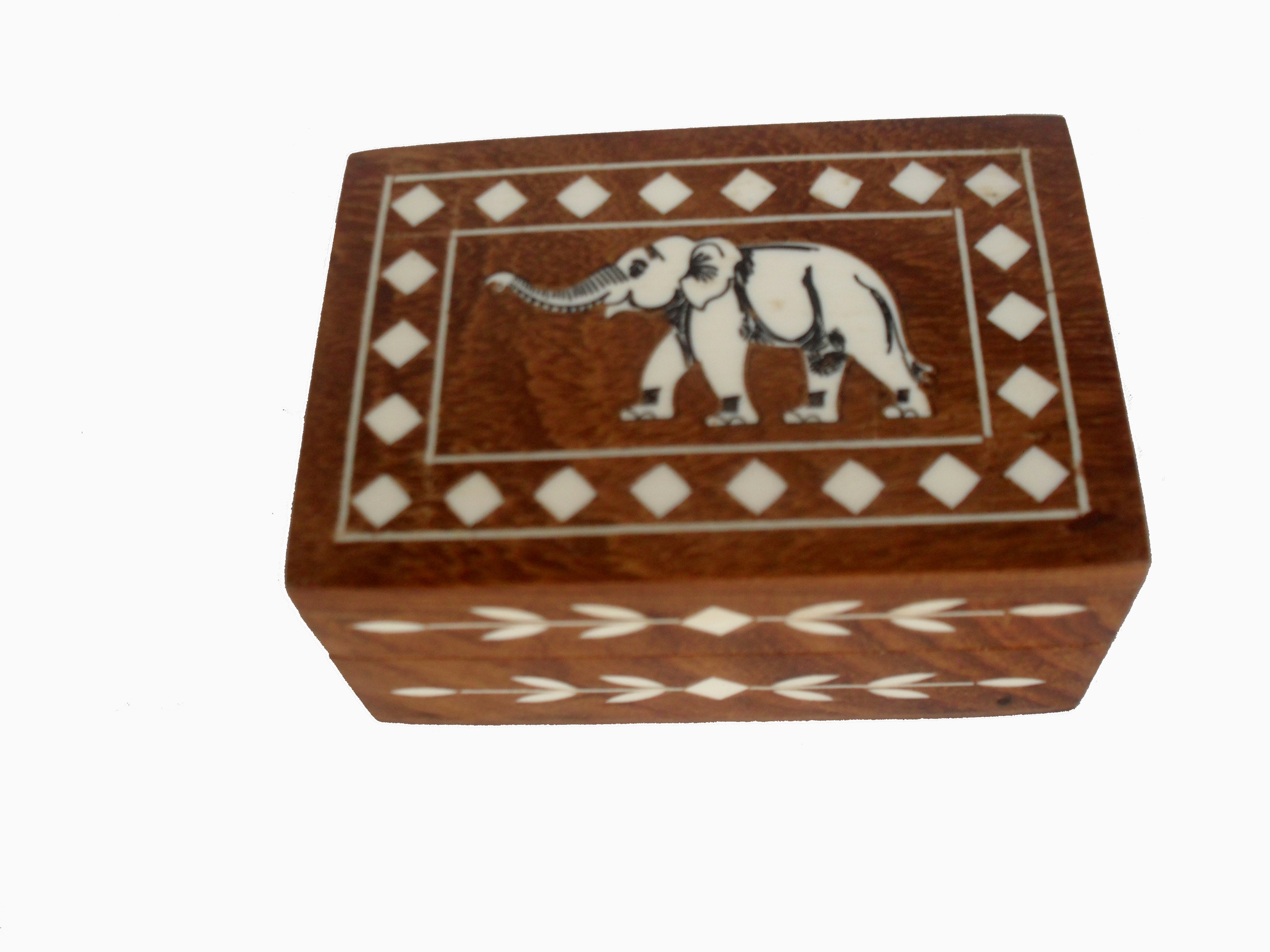 The small rectangle shape trinkate box is handicrafted from teak wood inlayed with elephant design on the surface of the box.This trinkate box is use to store your delicate jewellery, marble collection , deck of cards, charms and any other items of value to you.