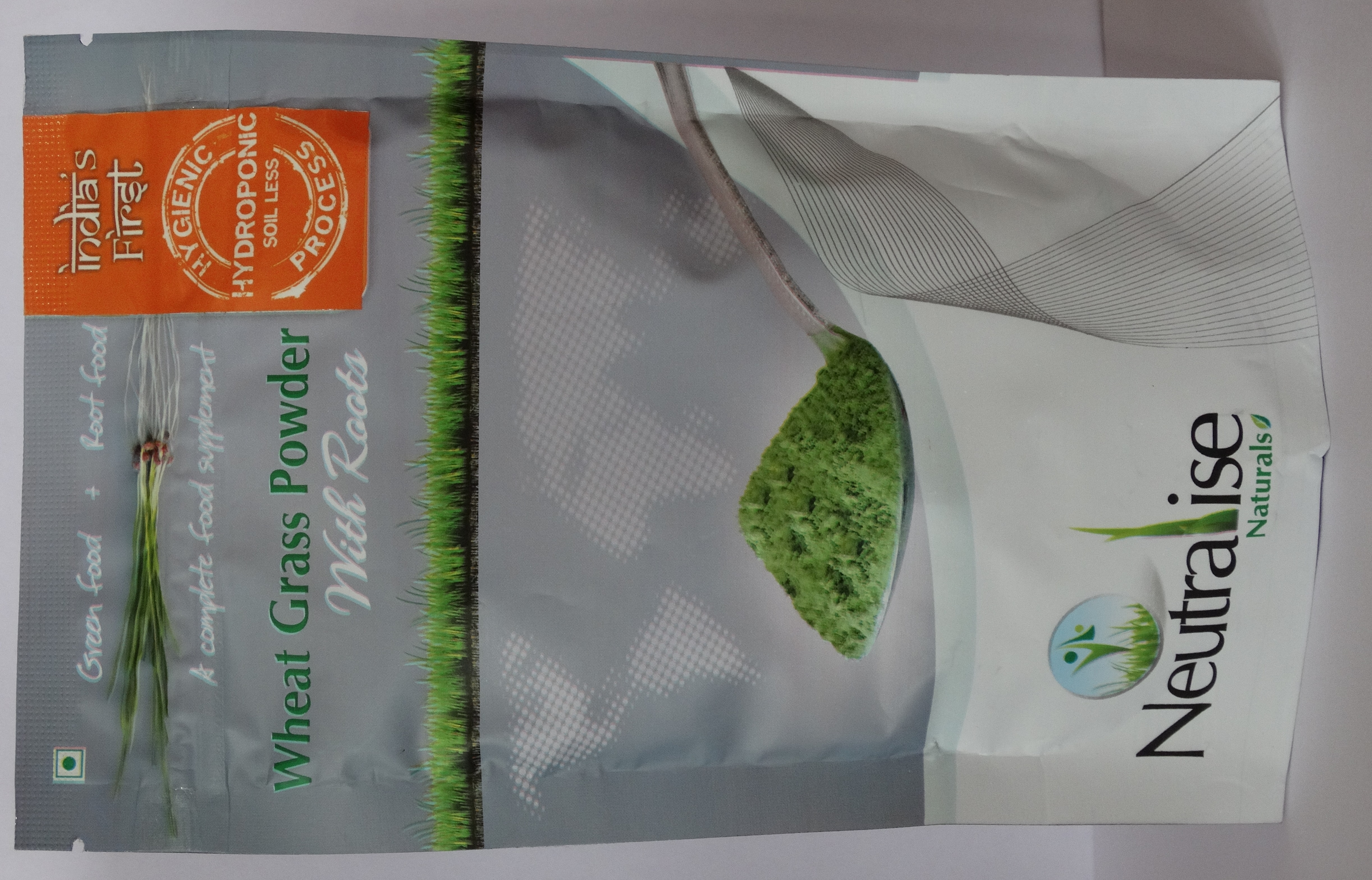 Unique Features of our Wheat grass powder: •We are India's first wheat grass powder with Roots, grown in a Hygienic, Hydroponic Soil-Less process.  •In this process the wheat grass is grown in an enclosed air-conditioned environment and harvested on the 7th day. Only single crop is used in this process and we do not go for 2nd and 3rd harvest.  •Neutralise wheat grass powder has better taste and smoother to consume when compared with other conventionally grown wheat grass products and has no mud smell or sediments. It contains no added flavour, preservatives or colour. •The leaves of wheatgrass have a cooling effect, whereas the roots produce a heating effect to the body, combining both these characteristics it Neutralises the effect produced by each individually.  •Roots have more number of amino acids and full of enzymes which help in faster wound recovery. •Roots have high fiber content and good amount of magnesium to improve the digestive system of the body and to deal with the constipation disorders.  Benefits of using Neutralise Wheat grass powder: •Best Detoxifier, and helps in decrease of fat levels. •Helps in Controlling blood sugar level, BP, cholesterol, cancer and thyroid. •Improves Immunity, energy levels and revitalizes the body.  •Improves digestion and controls acidity, helps for proper bowel movements. •Helps in anti greying of the hair, cure skin diseases, improves skin and muscle tone. •It provides the necessary vitamins, proteins, minerals, dietary fiber and chlorophyll.   •Maintains the hemoglobin levels of blood. •Slows down the aging process. •Helps to improve the reproductive health of both men and women.  •Helps to eliminate toothache and other mouth problems. •Helps to reduce body and joint pains and helps in faster wound recovery. •Wheat grass contains upto 70% chlorophyll, which is an important blood builder and neutralizes toxins in the body, helps to purify Liver and in normalizing blood pressure. •This is the simplest and most convenie