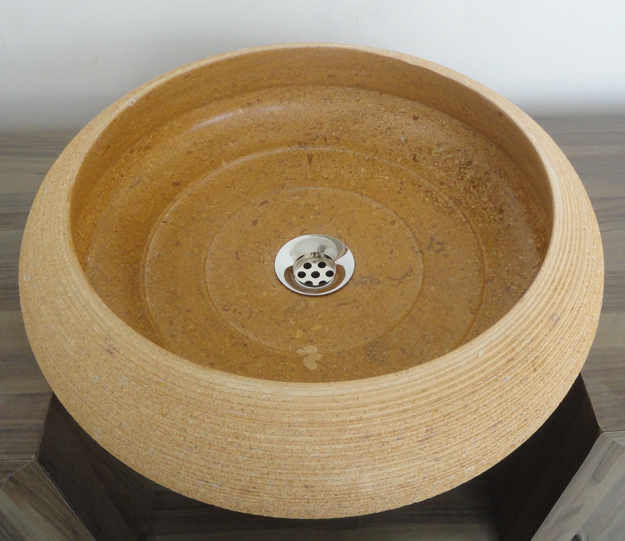 At Sikandra our endeavor is to convert the ideas and concepts of our customers on stone with the skills and art of our craftsman. Our master craftsmanship is evident from the customization patters we have followed in line with our customer's tastes. This sandstone beige basin is in popular demand because of stylish surface mounted base which servers a greater utility in this pattern and is available in all sizes. Series: Bowl Counter Top Used Material: Marble Specifications: Customize Our Standard: Ø -400, Ht-150 Weight: 40Kg/Pcs Including Packing Available at Ex-factory Price Available Colours: Black, White, Yellow,