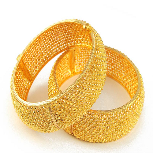 Gold Bangles  Matching up with the ever increasing requirements of the customers, our company is engaged in providing Gold Bangles.  Features:  Light weight Excellent finish Attractive design