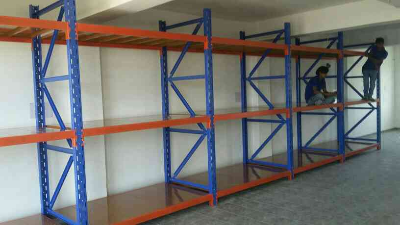 Slotted Angle Racks  Our company is manufacturing of Slotted Angle Racks in Rajkot since many years. We have skilled staffs and advance technology for precision working solution providing to our clients.  We are also giving customize solution as per client's demand and having proper technician to giving exact guidance.