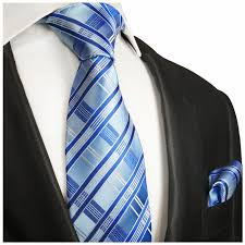 Neck Tie  Blue Colour Stripe Tie Looks Awesome With A Fine Finished Handkerchief, Beautifully Crafted To  Have A Different Looks. We Manufacture Each And Every Tie With Complete Satisfaction. Also, We manufacture Customized Ties As Per The Individual Requirements. For More You Can Connect To Us At : rolaxtiesdelhi@yahoo.com   We Are A Leading Manufacturer Of Neck Tie In East Delhi