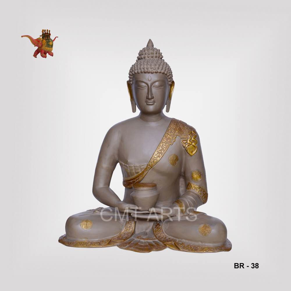 """The statue shows Buddha holding a pot in his hands and sitting in a usual meditation pose. The calm expression on his face is captivating and the well decorated Mukuta has utmost detailing on it.   The golden print on the brass made statue is simple yet attractive. The pot is also highlighted with golden border. The size is 18"""". The piece is available for wholesale price.   Key Features  1. Handmade 2. Indian Handicraft 3. Brass Buddha 4. Handicraft at wholesale price"""