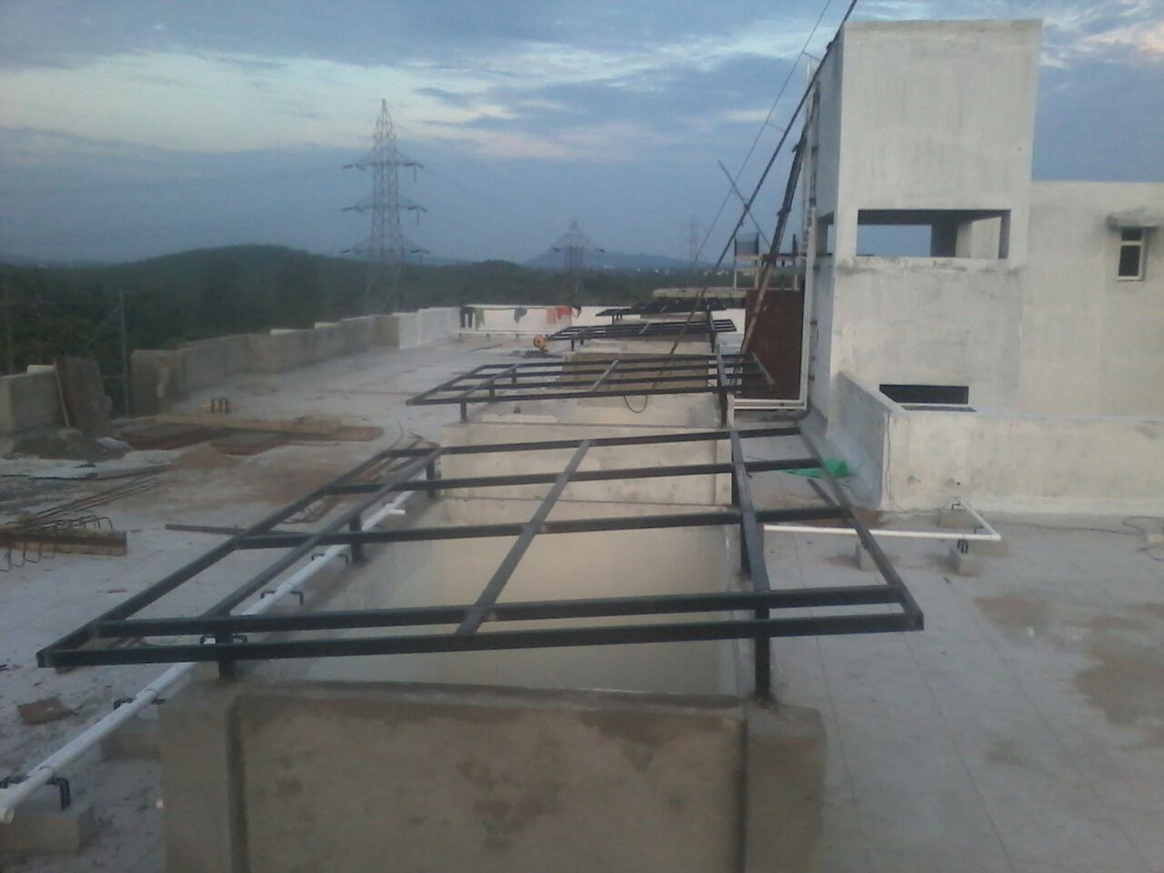 Open to Sky (OTS)  MS structural fabrication framework on the terrace floor level of a residential complex.