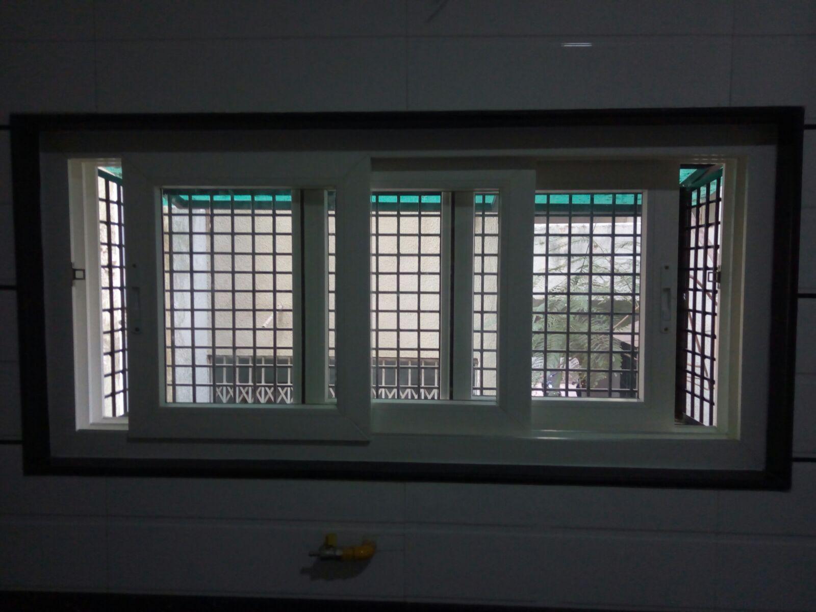 we are suppler of uPVC slide doors uPVC two track sliding windows uPVC three track sliding windows uPVC sliding with wire mesh sash uPVC sliding with mosquito net sash in Gujarat