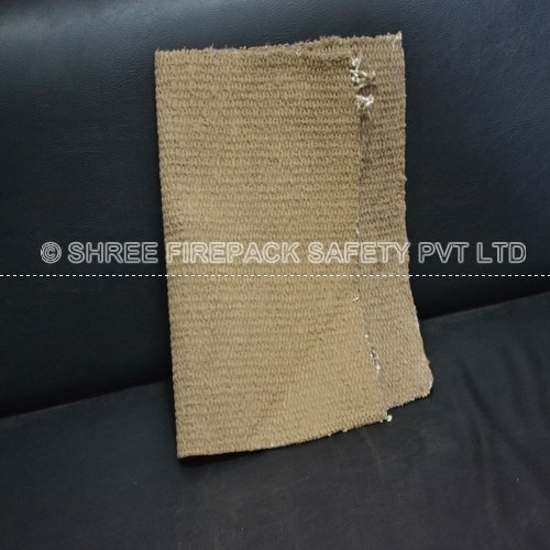 Vermiculite coated ceramic cloth from shree firepack safety pvt ltd.  You can also fill the recessed area of the brick with vermiculite or alumina let be coated with glass separator to prevent glass or ceramic glaze from sticking to them inside the kiln, remove the shelf and rub grit cloth over the glass separator.