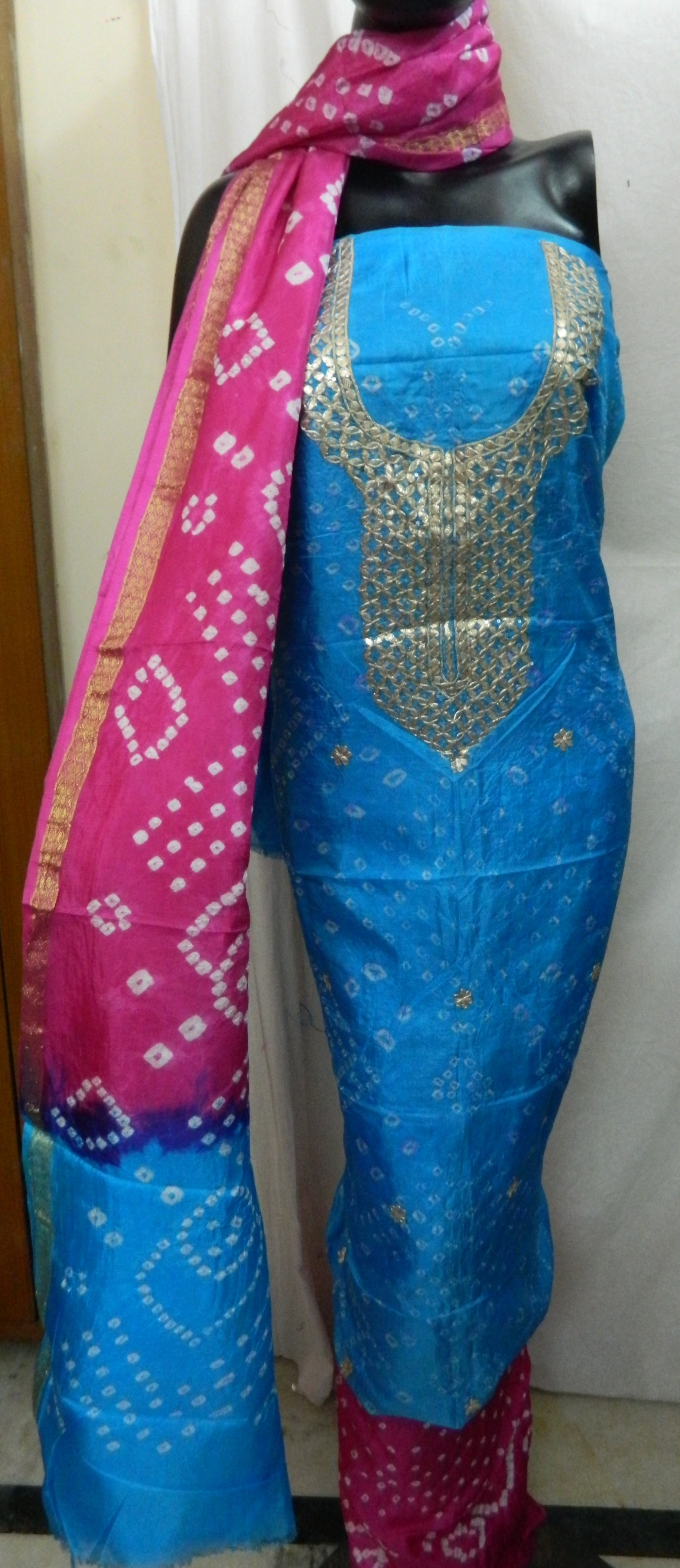 Hello,   Greetings from Aaditri Clothing from Jaipur. We are Manufacturer from Jaipur, Rajasthan.   Aaditri Bring To You Festival Offer.  Bandhej Art Silk Gota Patti Suit., .   Fabric  Top - Bandhej Art Silk  Bottom - Bandhej Art Silk  Dupatta - Bandhej Art Silk   Size -Top, Bottom, Dupatta- 2.5   Bandhej Art silk gota patti Suit in Different Color and many more items with effective & timely delivery.   Other Colour is available in this Design and Fabric.  You can order in Bulk than we will give you Best Prices.  You can order for Assorted Pieces or same pieces(as you like)   We are Manufacturer in Jaipur. We have Unstiched Salwar Dress Material. We have Chiffon Dupatta Dress Material ., Georgette Dress Material ., Chiffon Suit ., Cotton Dupatta Dress Material , Applique design, Cotton Suit , Designer Salwar Dress Material , Gota Patti Dress Material , Dobbi Dress Material , Embroidery Dress Material , Yok Dress Material , Patiyala Dress Material , Bandhej Art Silk Dress Material , Bandhej Dress Material , Block Print Dress Material , Block Print Gota Patti Dress Material , Chanderi Dress Material , Chanderi Gota Patti Dress Material , Zari Chanderi Dress Material , Patiyala Dress Material etc.