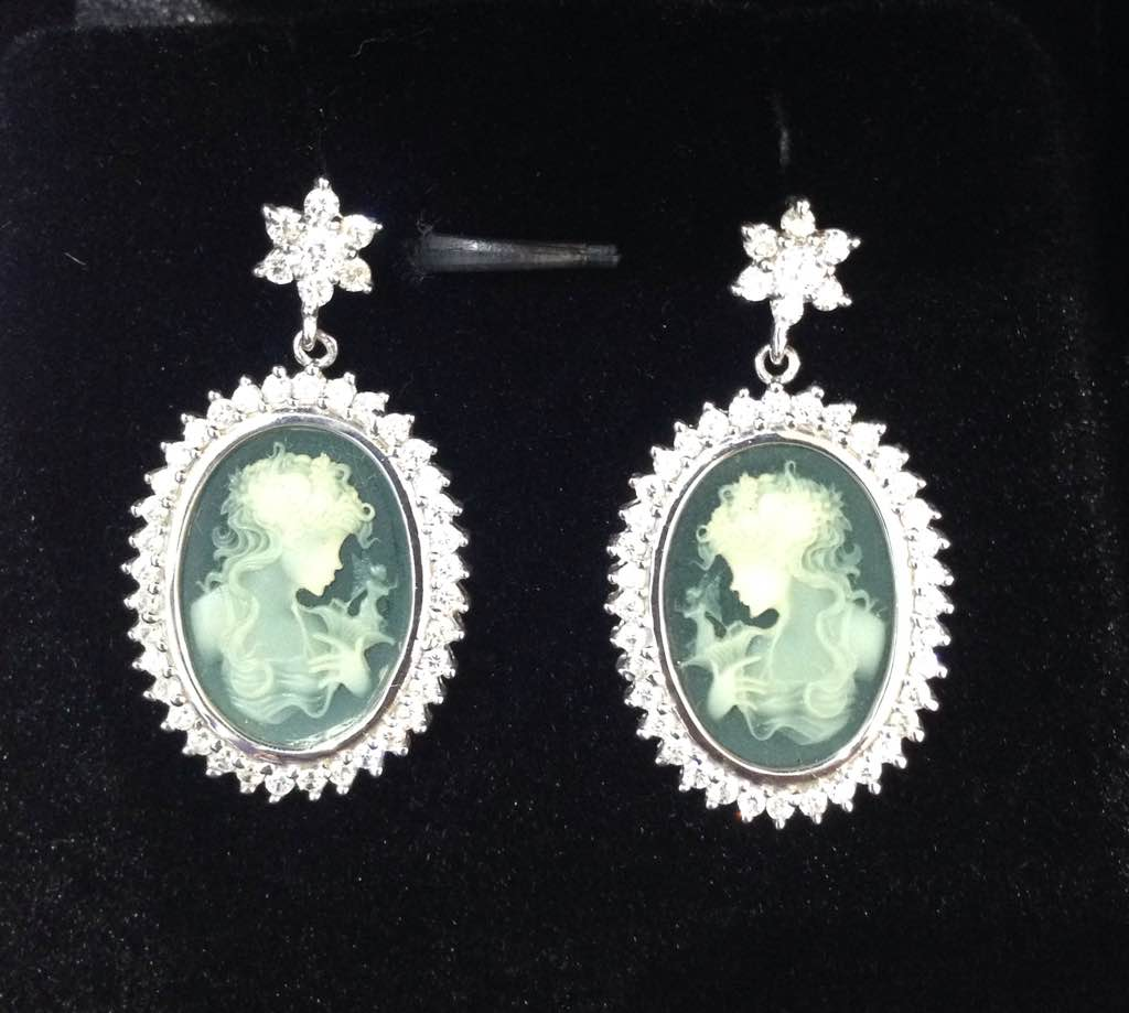 Sterling silver Cameo earrings with an extremely high accuracy laser carving done on the cameo. Mounted on a translucent green onex base and surrounded by cubic zirconia and coated with anti tarnish polish. Very limited pieces exclusively only at GLITTERS, Panjim.