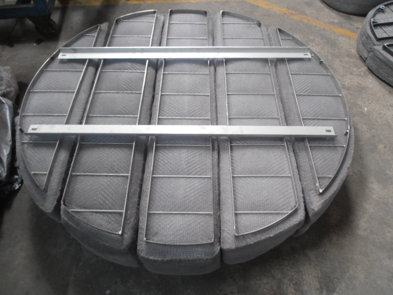 There are mainly two types of mist eliminators available: wire-mesh demisters and vane-type separators. In addition, non-irrigated packed bed stages can also work as mist eliminators. The efficiency of mist eliminators is expressed by the rate of separation for a special droplet size. Finepac offers high efficient Mist eliminator and fabrication in India.