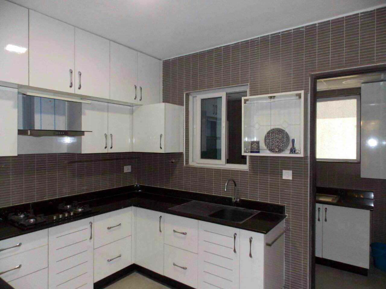 Modular kitchen in black and white - Modular Kitchen In White With Utility Area This Is A L Shaped Kitchen With