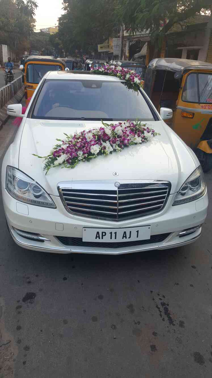 Wedding car rental in hyderabad-Car hire for wedding in hyderabad-Decorated wedding carsin hyderabad-Exclusive luxury cars for wedding at famous travels and wedding cars