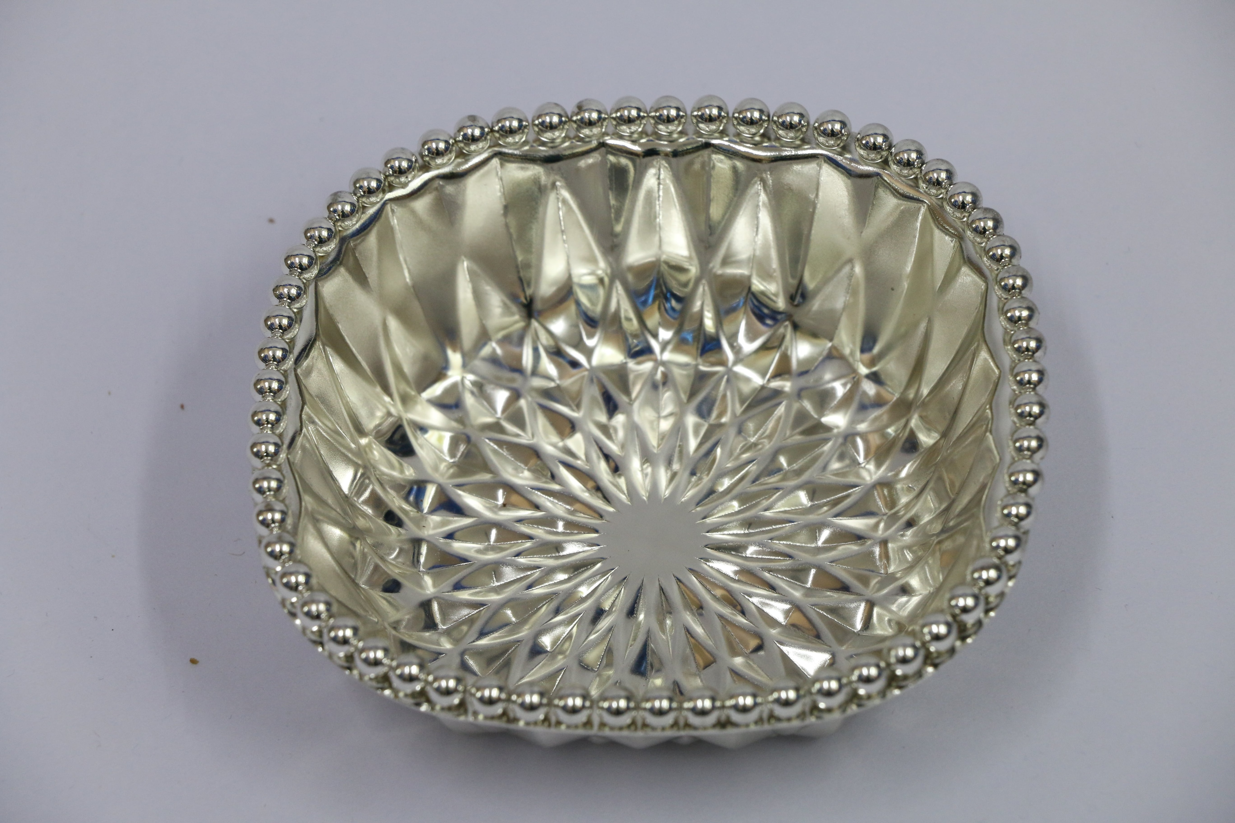 German Silver Plated and Imported bowl in Bangalore Sambhav Products  We also import products as well as export.  German silver plated bowls gives an elegant look.  Shape : Square Metal : German Silver Plated  Quality : Superior Quality  Long Lasting Period : 10 Years.