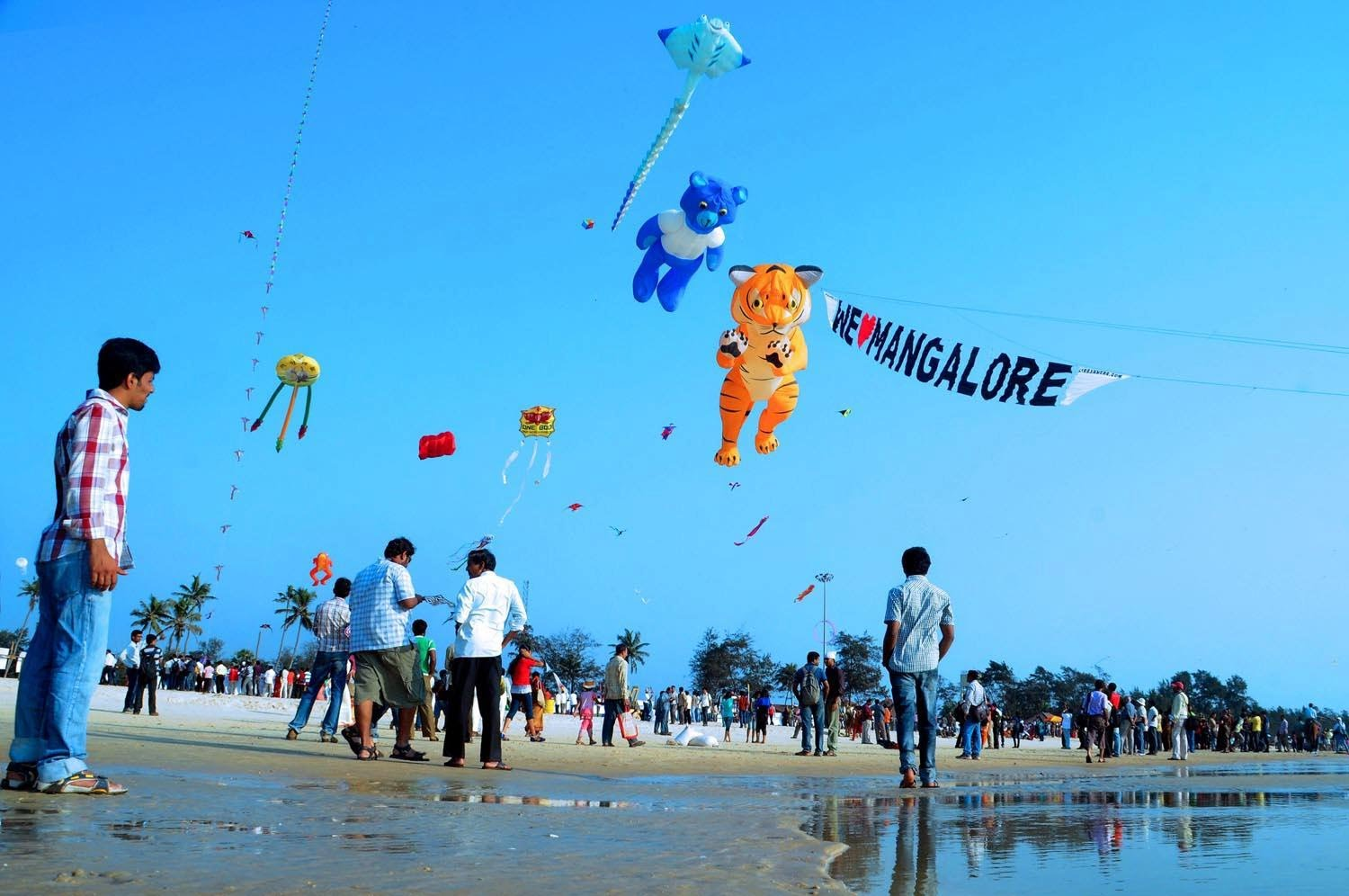 Best travel websites in Mangalore Close to the New Mangalore port is the Panambur beach, one of the most loved, pristine, clean beach in the city. The blue skies, sea and sands, get a dash of color during April, as the beach hosts a kite festival.