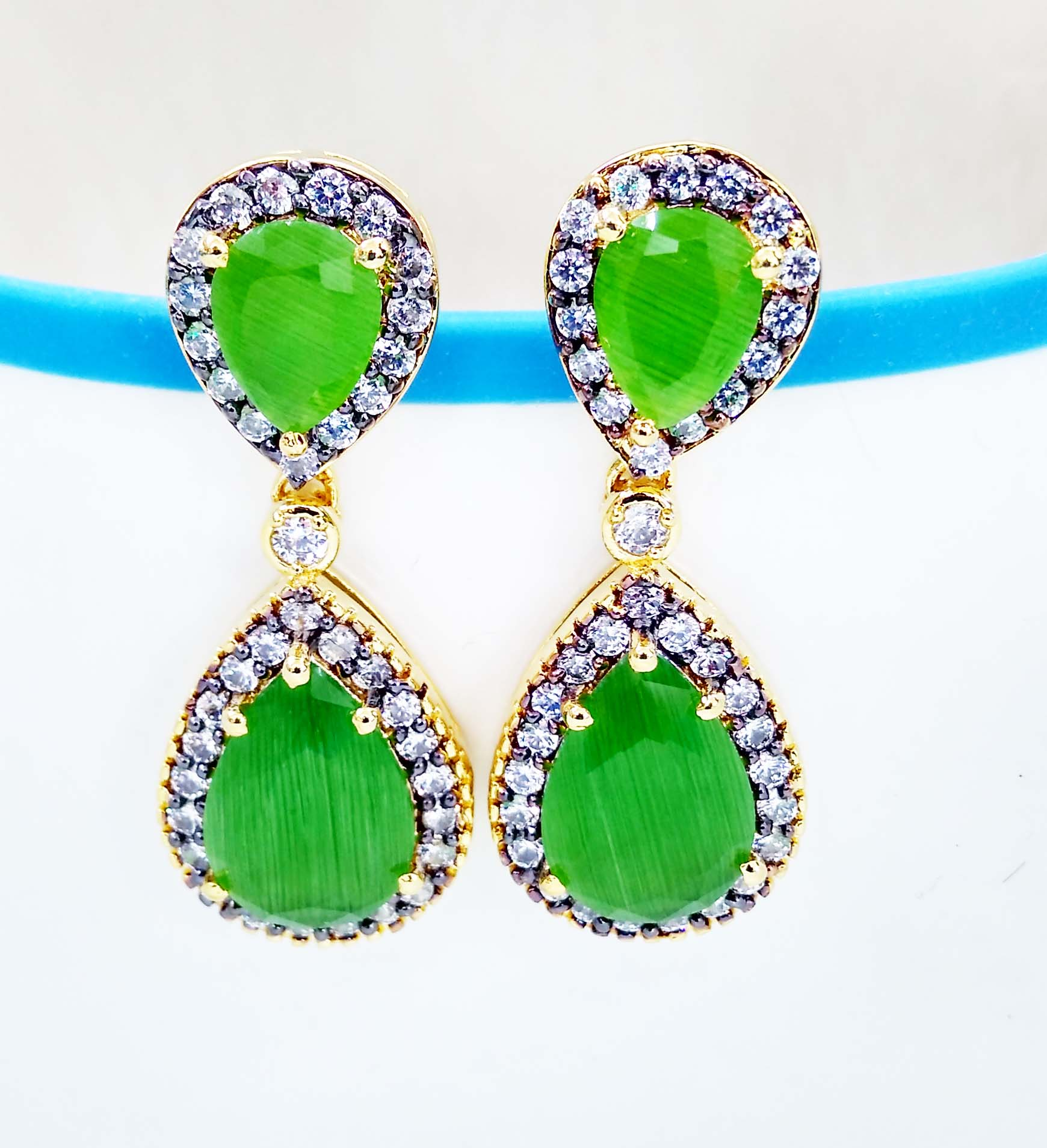 Fancy CZ Stone Earring.  In order to fulfill the ever changing demands of our respected clients, we are engaged in offering Fashion CZ Earrings. The offered Fashion CZ Earrings imparts an attractive and royal touch to the persona of wearer. This Fashion CZ Earrings is beautifully designed and crafted using quality tested CZ, Color Stone and latest techniques by our agile professionals. Furthermore, our offered Fashion CZ Earring is provided in proper packaging for assuring its quality  .  Features:  Exquisite pattern  Unique design  Eye-striking appearance   Other Details:  Made from copper & Brass  High Gold Polish  Skin friendly Material  Stylish look  Elegant Design  suitable for any outfit  Best Wholesale Prices  Best Quality  Fastest Selling Designs.  Manufacturer Fashion CZ Earring.