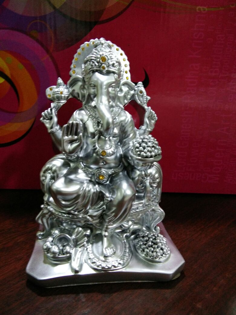 Buy White Metal German Silver Ganesha Statue Online  German Silver Ganesha Statues serve as an ideal gift for functions like House Warming or Weddings....  Shop Online Now : 93630 00130