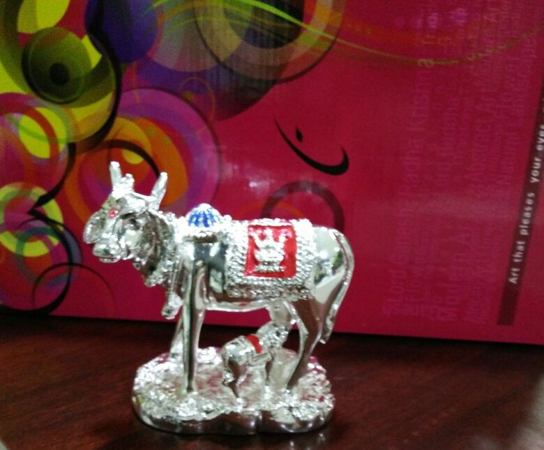 White Metal Gift Items | Kamdhenu Statues from Signatures, Tirupur.  White Metal Decorative Kamdhenu, Cow with Calf Statue is an exclusive item for #gift as well as Home Decor. These Statues are used to improve the appearance of the interiors.  Shop Online Now : 93630 00130