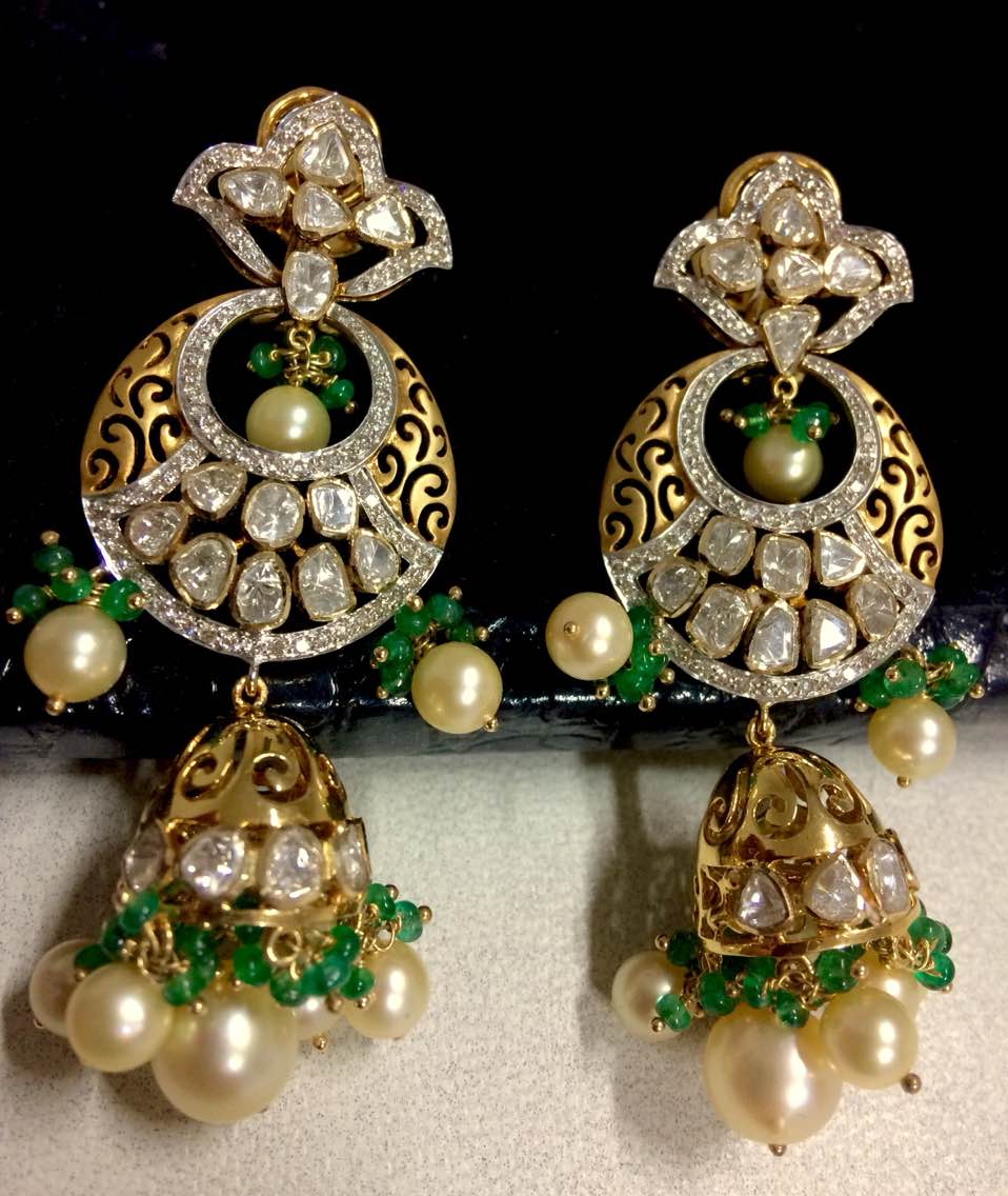 Designer Diamond Polki Earrings studded with south sea pearls and Brazil emerald beads with a tint of Gold Cutwork is as mesmerising and majestic as a dew drop on a petal. Enquirer us for more designs and Wholesale Manufacturing.   Polki Uncut Jewellery, a new line added to Valentines Jewellery.