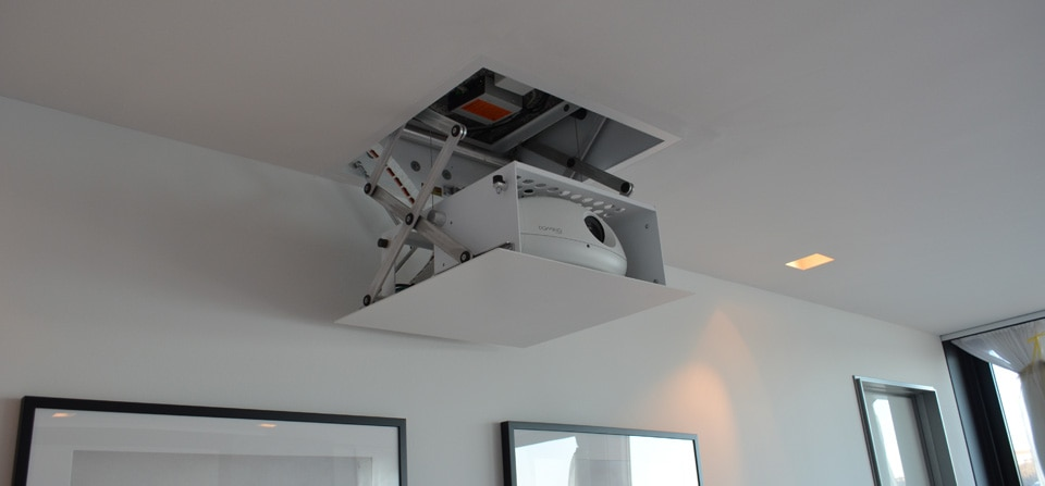 Want to hide your projector in the false ceiling? Don't want the projector to be visible in the center of your room? Want a design which is neat and tidy? Try our projection lifts! They enable you to hide the projector inside the false ceiling and it retracts at the touch of a button. The bottom panel can be customized according to your false ceiling design. Call Viewtech Hyderabad for a consultation today.