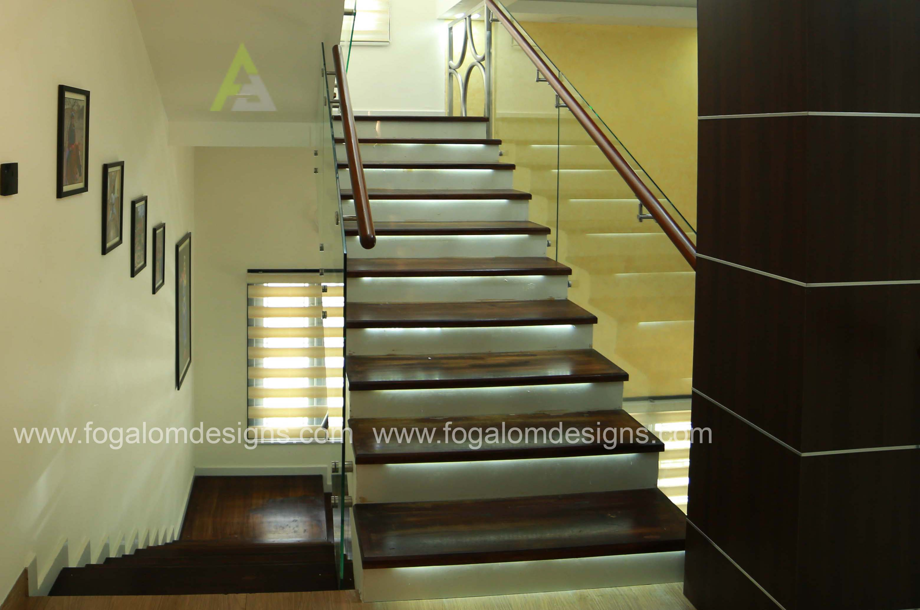 STAIRCASE   Home Interiors  Kochi -  Ernakulam  Dinning - Kitchen - Living rooms & Bed rooms  Designers : Fogalom Designs  for more details : 9895757687 , 9605422333  visit our site here : www.fogalomdesigns.com