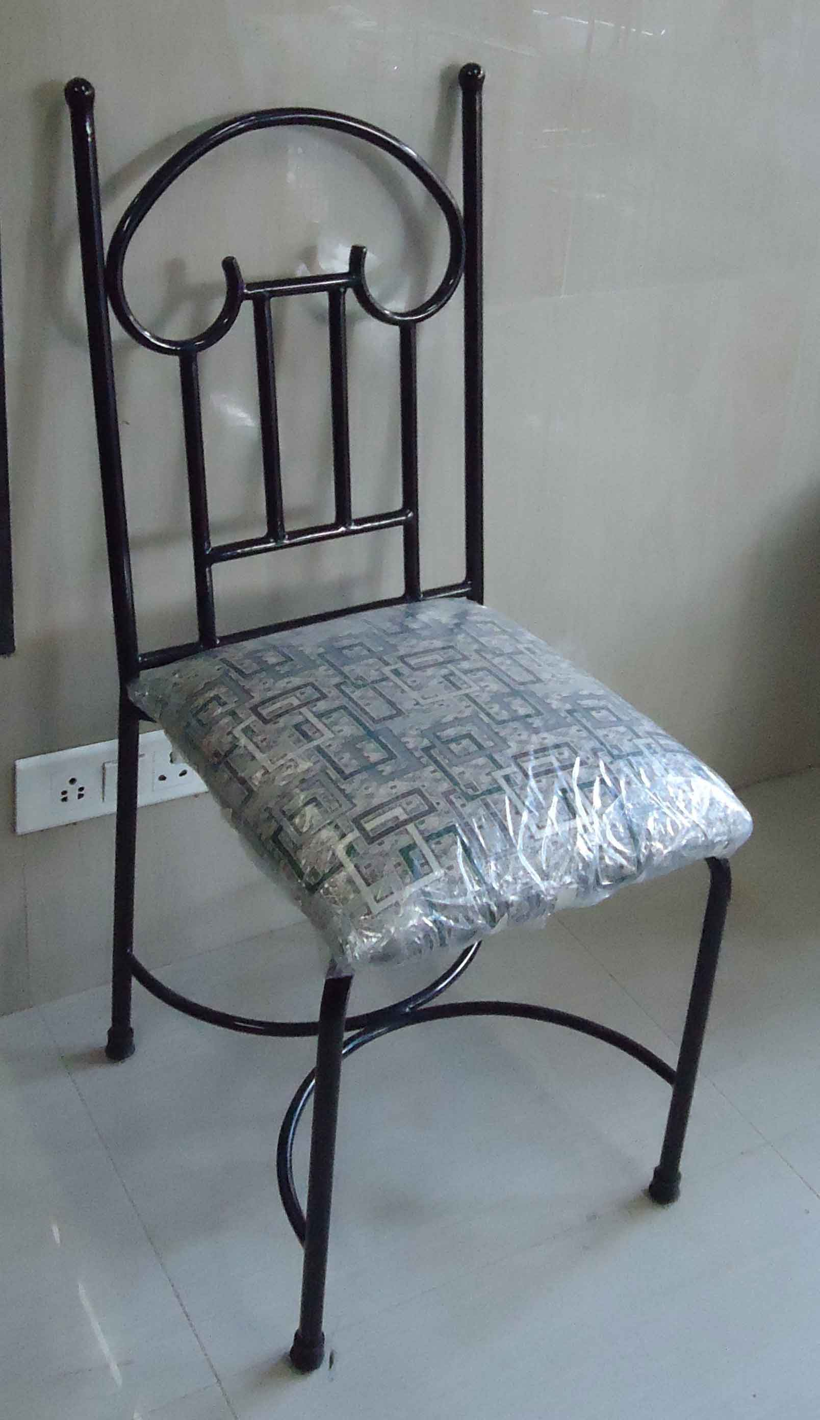 Dining Chairs : We are manufacturers of wrought iron furniture which includes , Dining sets , Double and single beds with and without storage , sofa cum beds , bunk beds , Sofa sets , swings etc . These are made in good quality wrought iron and are powder coated in colours of customers choice . We also make customized furniture as per the design and size requirements of the customer