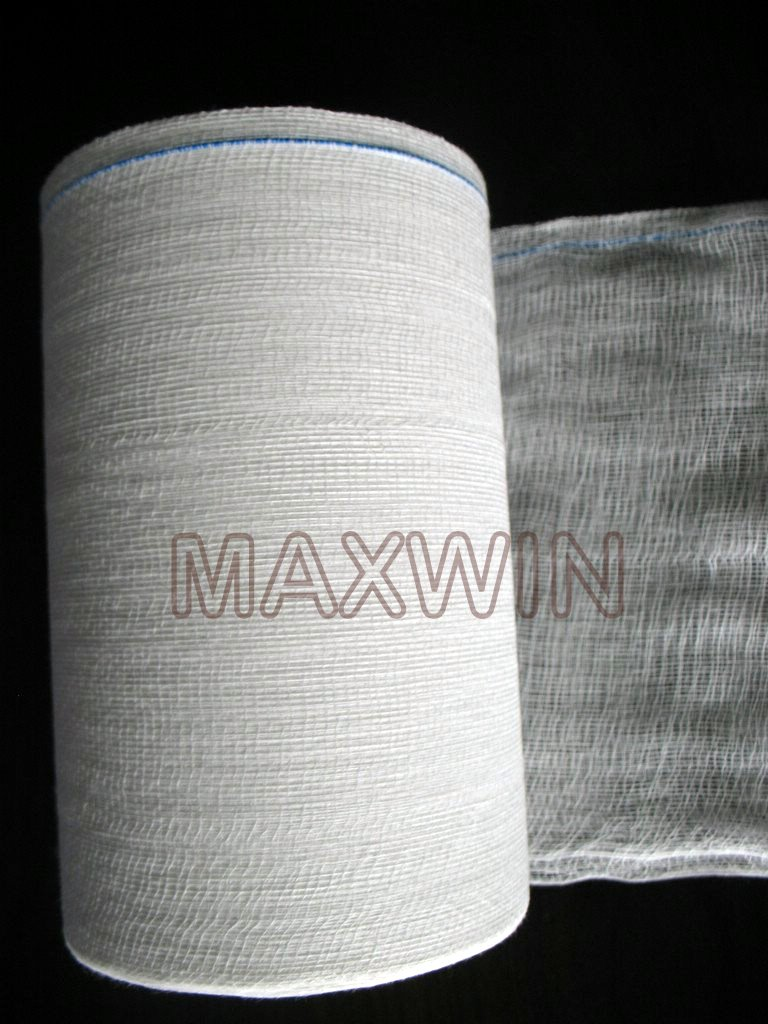 """4 Fold Gauze Roll Manufacturer in India   We manufacture high quality CE certified Absorbent Cotton Gauze roll.   * CE CERTIFIED   * Thread Count - 40's   * Mesh per inch - 12/8, 19/15, 20/12, 24/12   * Width & Length - 36""""x100 yds/4 ply Roll & 36""""x50 yds/4 ply Roll"""