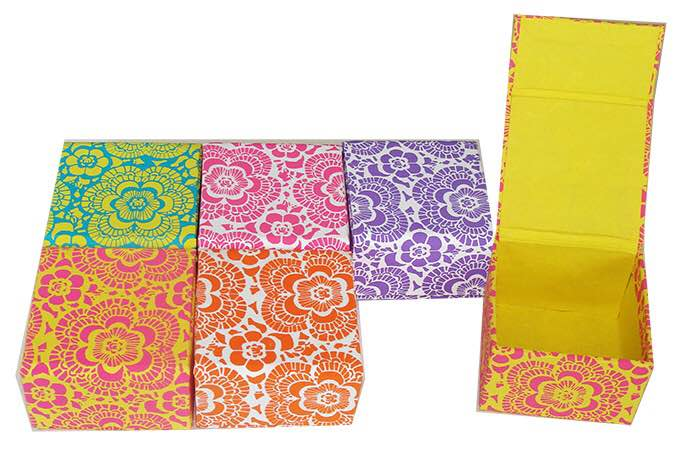 Handmade Paper Boxes  Traditional Print Handmade Paper Boxes with a flap cover available in different colours and also in set of six. Paper used in boxes is 100% Recycled. Vegetable dye is used in it. These Boxes are Made in India.   Handmade Paper Boxes, Different Colour available, Vegetable Dye, 100% Recycled Paper.