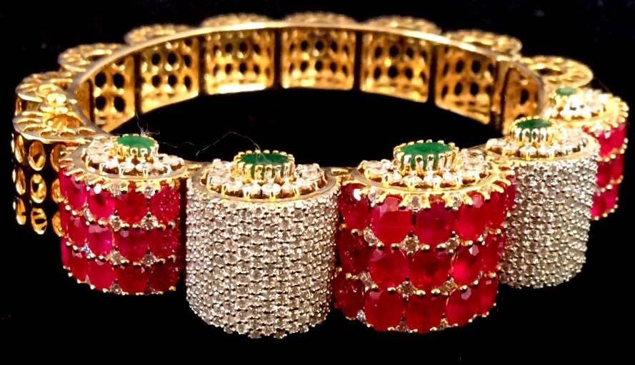 Delicately designed to make your glance divine by adding every luxury that you want in your Jewelry Box. Get  such Heavy Emerald Ruby Diamond Studded Gold Half Bangle Kada and more of Designer Gemstone Jewellery To Color yourself up in classy way. Experience our Fine Jewelry by dropping by at our Jewellery Store In Jaipur or mail us for further queries...