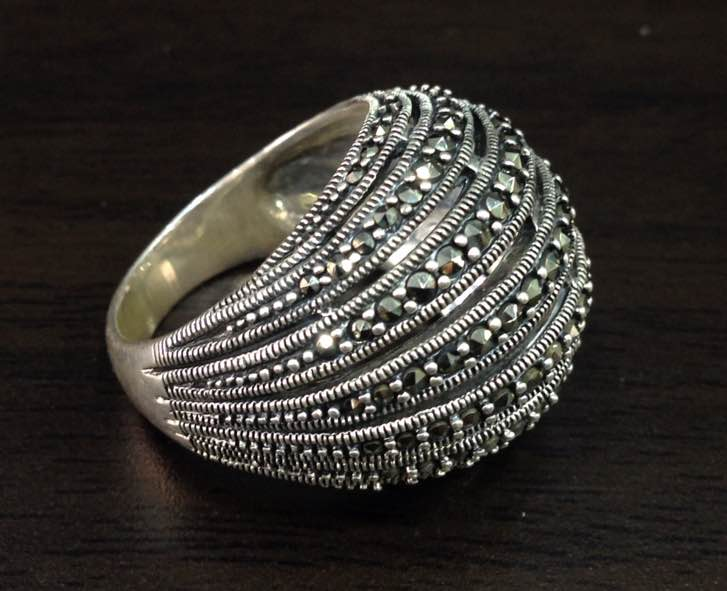 Sterling Silver Marcasite Ring. Precision crafted cocktail ring that boasts the big size shimmering Marcasite stones. A perfect companion for an indulging evening !