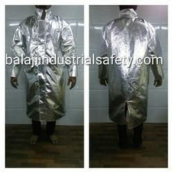 "Manufacturer and Exporter of Aluminized Coat in India:-  We are Manufacturer and Exporter of Aluminized Coat in India which is made out of imported Aluminized Glass Fiber fabric with dual mirror having 90% reflection of heat as a outer layer and with woolen fabric lining. Additional layer (Vapour Barrier), stitch with 4 Core aramid yarn, is also used for higher temperature and to work near close proximity area.  Feature:  •	Temperature capacity 800 °C to 1200 °C •	long lasting , Easy to wear, comfortable. •	Aluminized Glass Fiber fabric with dual mirror having 90% reflection.  Size of Aluminized Coat :- Long 48"", Inches, Chest 54"" inches, Sleeves 22''   Applications:  •	These Aluminized Coat are used for in rescue operations in an area of intense heat, fire, steam, hot liquid by fire fighters in industries like petrochemical plants, Foundries, plant, steel, glass, ceramics & defence.  Additional Information:-  •	We are MANUFACTURER AND EXPORTER OF ALUMINIZED COAT. So we can customized the Aluminized Coat as per your requirement."