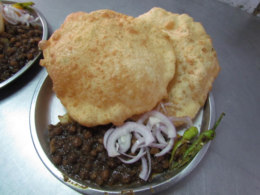 Baba nagpal corner  If you will to experience one of the best taste of chole bhature in south delhi then baba nagpal corner won't disappoint you. With his appetite quenching quantity and mouthwatering quality he is no doubt amongst the best food joints in south delhi. Not only this, he is well known for aaloo kachori and dal samosa which are amongst some of the highlights in his menu. The price is also quite affordable as the quality they offer surpasses the price they charge.  Where: Gupta Market, Lajpat Nagar  Price: Rs.60 per plate  Timings: 7:30 AM – 6:00 PM  Nearest Metro Station: Lajpat Nagar  Explore More: https://www.delhipedia.com