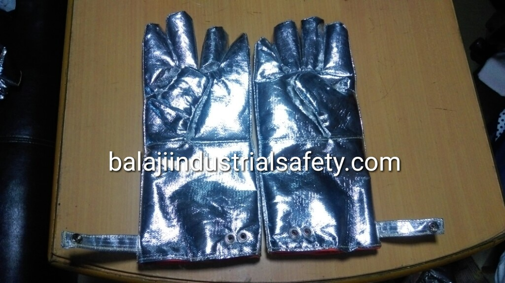 Manufacturer and Exporter of Aluminized Hand Gloves in India :-  Our product is highly resistant and durable. They are offering lighter weight which is giving them user flexibility. It is highly Used In foundry and all metal plants. It Asbestos Free Material. Aluminized Hand Gloves is made of Aluminized Fiber Glass Fabric and Supported With Woolen Fabric and stitched with Kevlar Thread.   Features:   High quality Fabric  Highly resistant to all kinds of hazards  Available in different size and thickness  Our product is cost effective  Temperature: 800 To 1200 Centi-degree   Specifications:  Aluminized Fiberglass with supported of woolen Fabric From inside  Size: 14