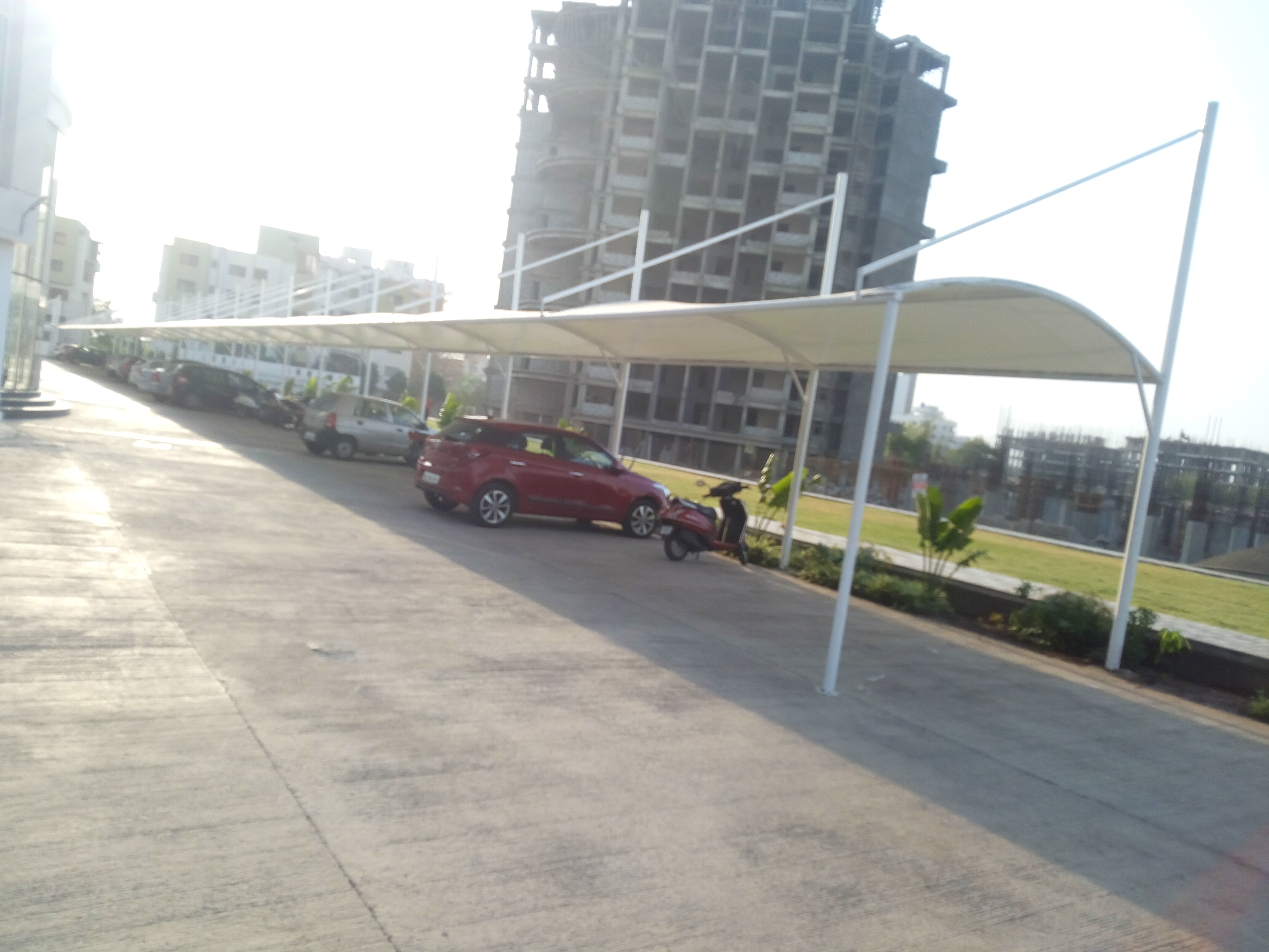 Beautiful tensile car parking shade  manufacturers , supply and installations ,