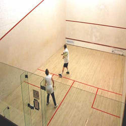 Indoor Squash Court  We provide Squash Court that is highly appreciated by schools, offices, clubs, sport organizations, and so forth. Technically advanced design and sound layout system make the Squash Court highly efficient. Our Squash Court is made in accordance with the standards of WSF (World Squash Federation). It comprises kiln seasoned/dried imported American hard maple or European sycamore wood surface board that offers it durability. The below frame is fabricated from fir/spruce/pine wood runners which is imported from New Zealand/Australia or Germany. Our Squash Court meet all the safety requirements and building codes owing to which it can easily withstand the breakage.   Specifications:  Court size : 975 cm (32 feet) length and 640 cm (21 feet) wide Front Wall Line : 457 cm (15 feet) above the floor that is connected by a raking