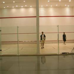 Squash Court Flooring  We C3Serface are manufacturing and supplying of  Squash Court Flooring in Mumbai.  As well as in India. In order to fulfill the changing demands of our customers, we are offering a quality range of Squash Court Flooring.These products are manufactured by the experienced professionals keeping in mind the impact loads, which are created when players or spectators run against the wall. The walls of the squash courts are tempered, toughened and celled for playing & viewing.   The Wall:    The walls of squash courts have flexural strength and provides excellent impact due to the superior quality raw material used in manufacturing. These walls are appreciated for their features such as resistance against crack, excellent bond, high durability and low maintenance cost. Moreover, we offer our customers a wide choice of standard alternatives in either freestanding or fixed-head types. We also offer a complete range of option for side and back walls for permanent tournament venues.     Glass Wall Fittings:     The glass wall fittings offered by us are manufactured in conformation with the WSF standards & specifications. These fittings are of high quality and have excellent strength nylon pieces, which help in strengthening a glass wall in the clients' squash or racket ball court. Our offered wall fittings are small and clean shaped to prevent any annoyance for players and spectators. Moreover, these fittings are FP four panel freestanding type along with full height glass support fins. The products have SP two panel freestanding version, which are made on the special order of the customers.     Resilience & Appropriate Friction:     The offered wooden floorings are manufactured by the professionals following the norms laid down by FIBA, WSF and MFMA in all aspects. These floorings provide controlled ball bounce as well as perfect comfort underfoot. Our floorings are highly resilient and are preferable for free floating sports floors. Each and every piece of the flooring is seasoned, tongue and grooved with utmost perfection and coated underneath with polyurethanes for moisture proofness. Moreover, these are manufactured by the experts from single stripe, solid wood. Each board measuring 18/20/22 mm thick and width of 57 mm to 87 mm. Staggering length measuring from 450 mm to 1350 mm.   More Information:         Suitable for basket ball or indoor volley ball, gymnastic and aerobics     Provided by us in varied species, maple-steam beech-hevea and teak     Stripes glued to form a single piece of 20/22 mm x 129 mm x 1830 mm in Hevea, WSF approved flooring for squash courts and badminton flooring     Dedicated sub-constructions