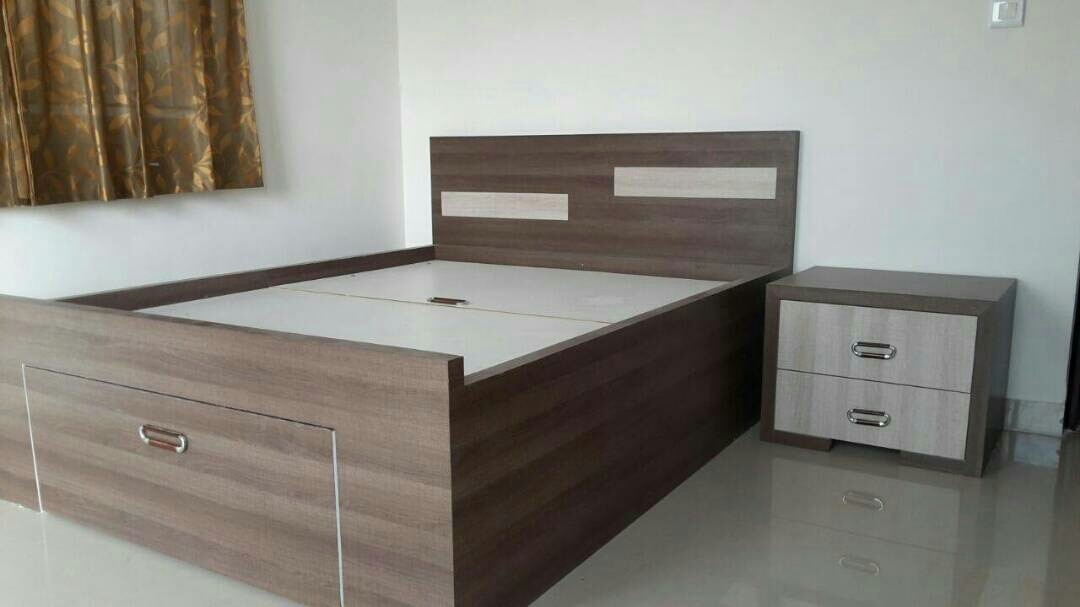 Queen size cott  done by Sai interiors belathur