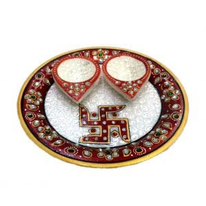 This gorgeous marble thali from siddh arts jaipur is chic, classy and ticks all the right boxes. A lovely, traditional pattern forms the border of the plate.