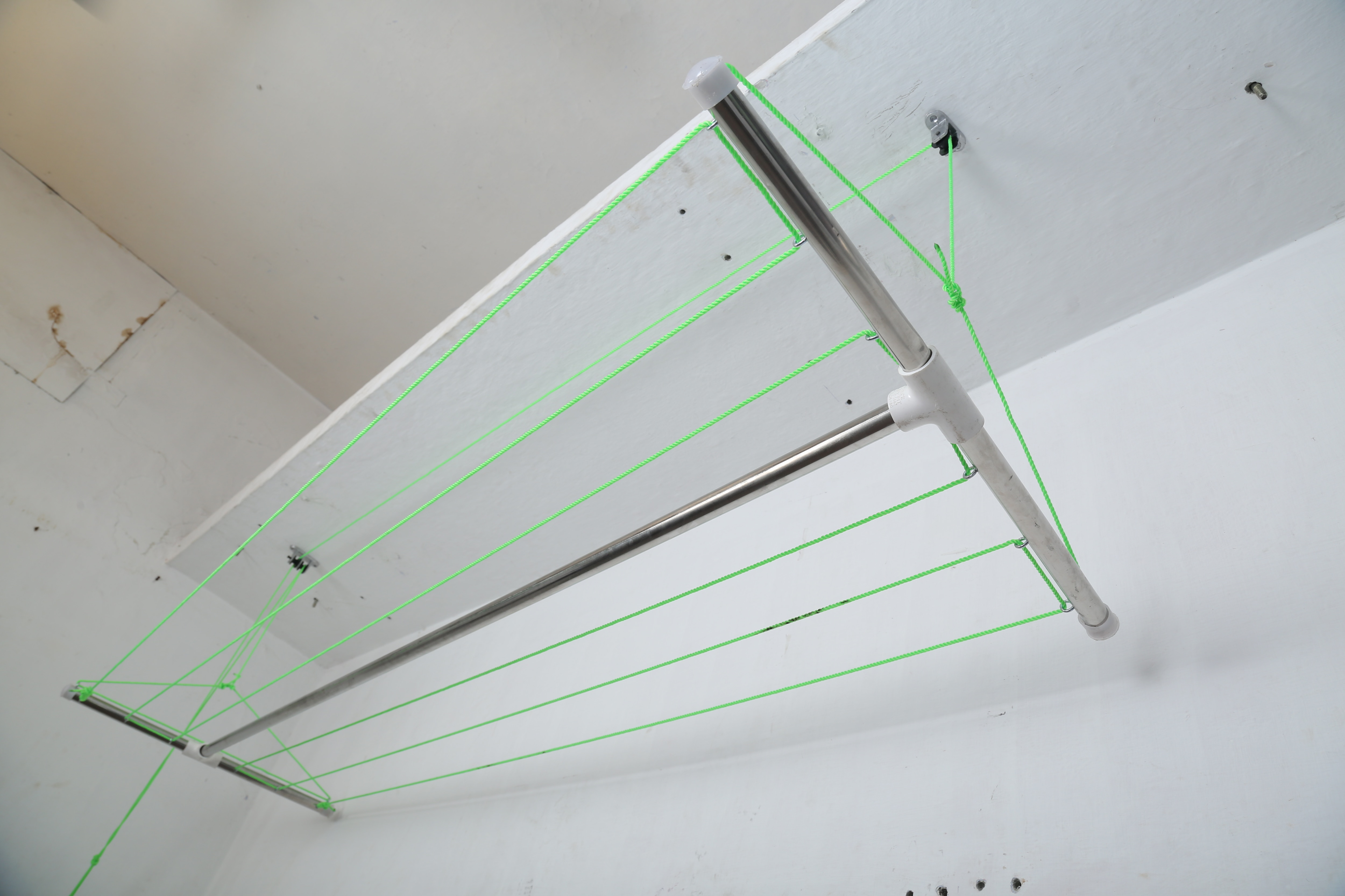 Apartments Balcony Hangers In Coimbatore   Apartments Balcony Hangers Stainless steel support frame.Apartments Balcony Hangers 6 mm Nylon hanging rope / SS pipe. Apartments Balcony Hangers Set of 6 row x 6 feet rope length.Apartments Balcony Hangers 36 feet drying length.