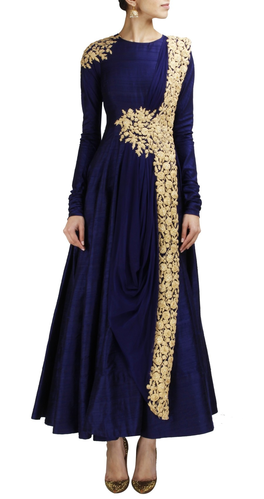 Lush trees, blossoming flowers and chirping birds of Rajasthan come alive in solid hues and striking motifs in our navy blue, cotton silk, gown  paired a attached dupatta on neckline and work  with extended sleeves and a boat neck, along with a pure dupatta style drapes with border detailing.panisha handcrafted gown make a perfect match for the esteemed occasions.   whatsapp no - 9530053233