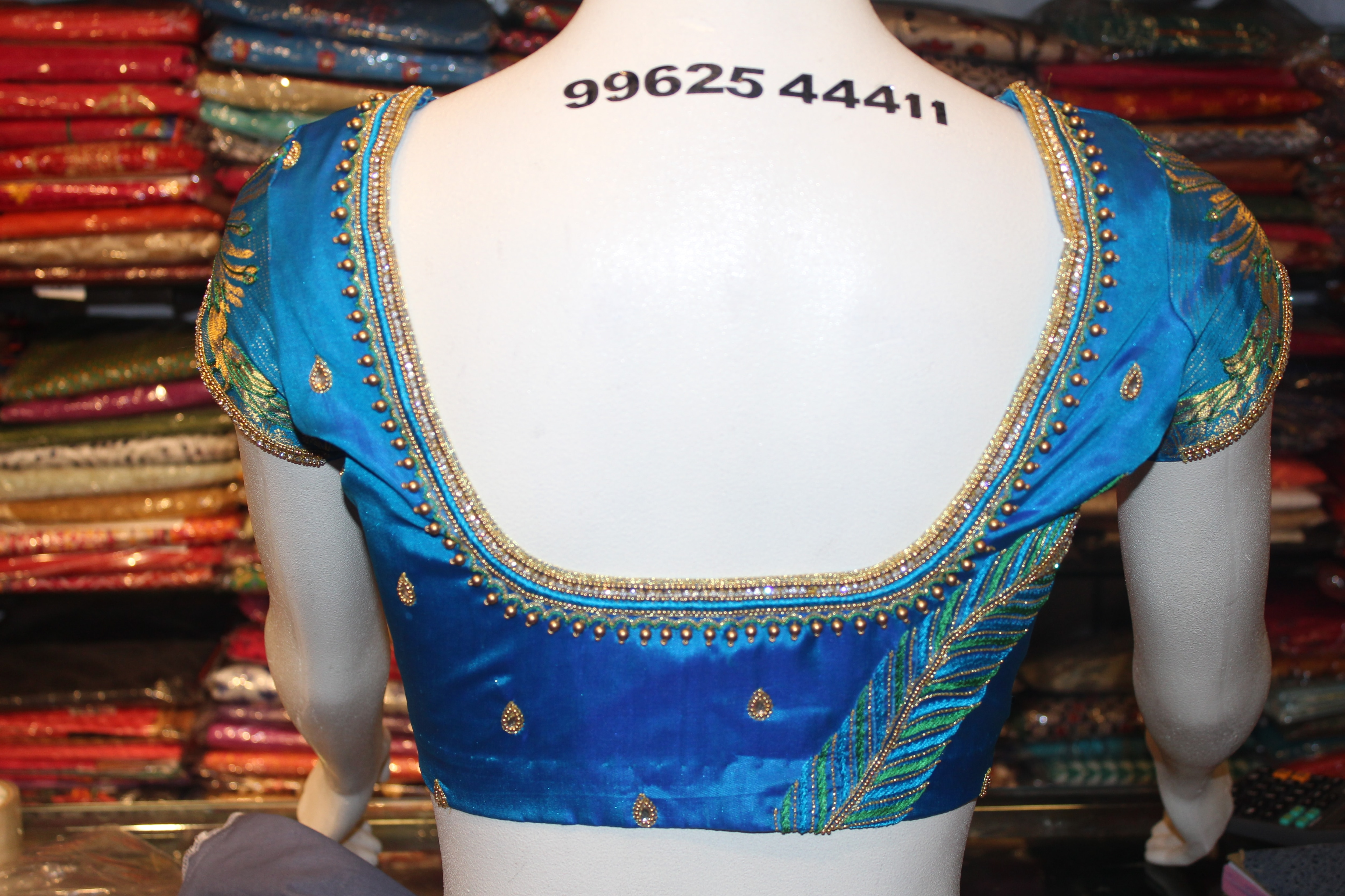 Blue Thread And zari Work Embroidery Wedding Blouse At Fabloon Fashion Boutique And Designer Embroidery Tailors   blouse Tailors  embroidered blouse silk blouse Wedding Blouse Stitching