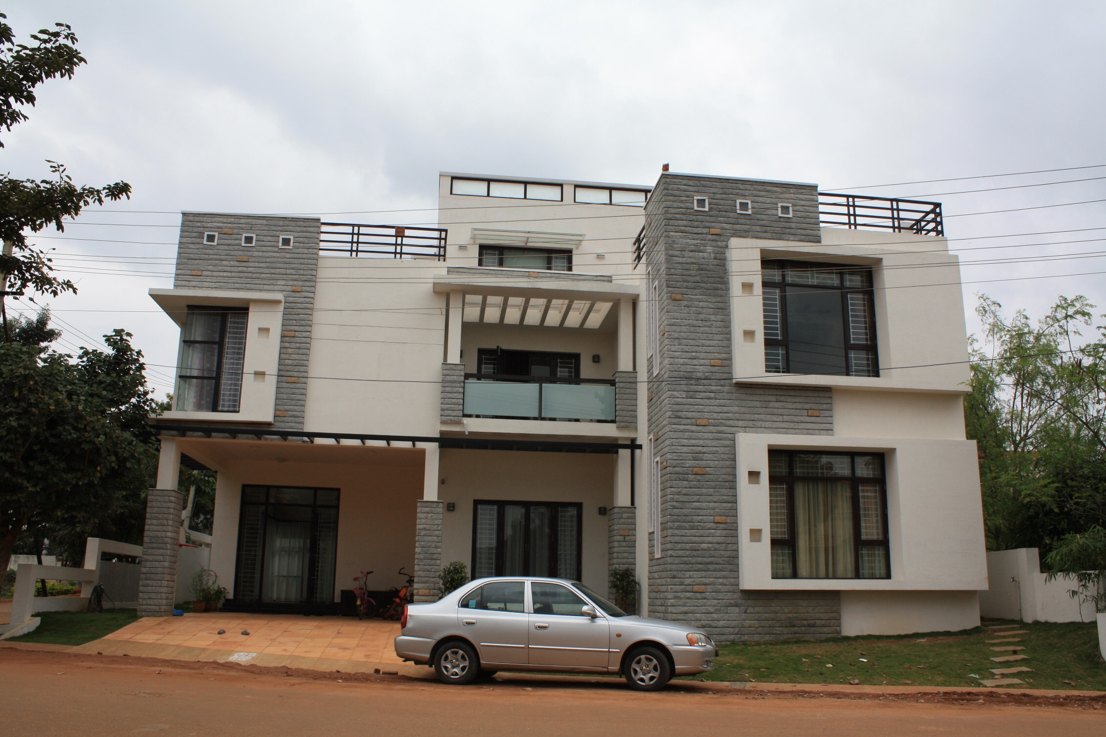 Modern architecture . contemporary elevation and latest design by top architects . leading architects in Koramangala, Bangalore. montimers 08025534834 08041677116 www.montimers.in htts://www.hozz.in/pro/montimers