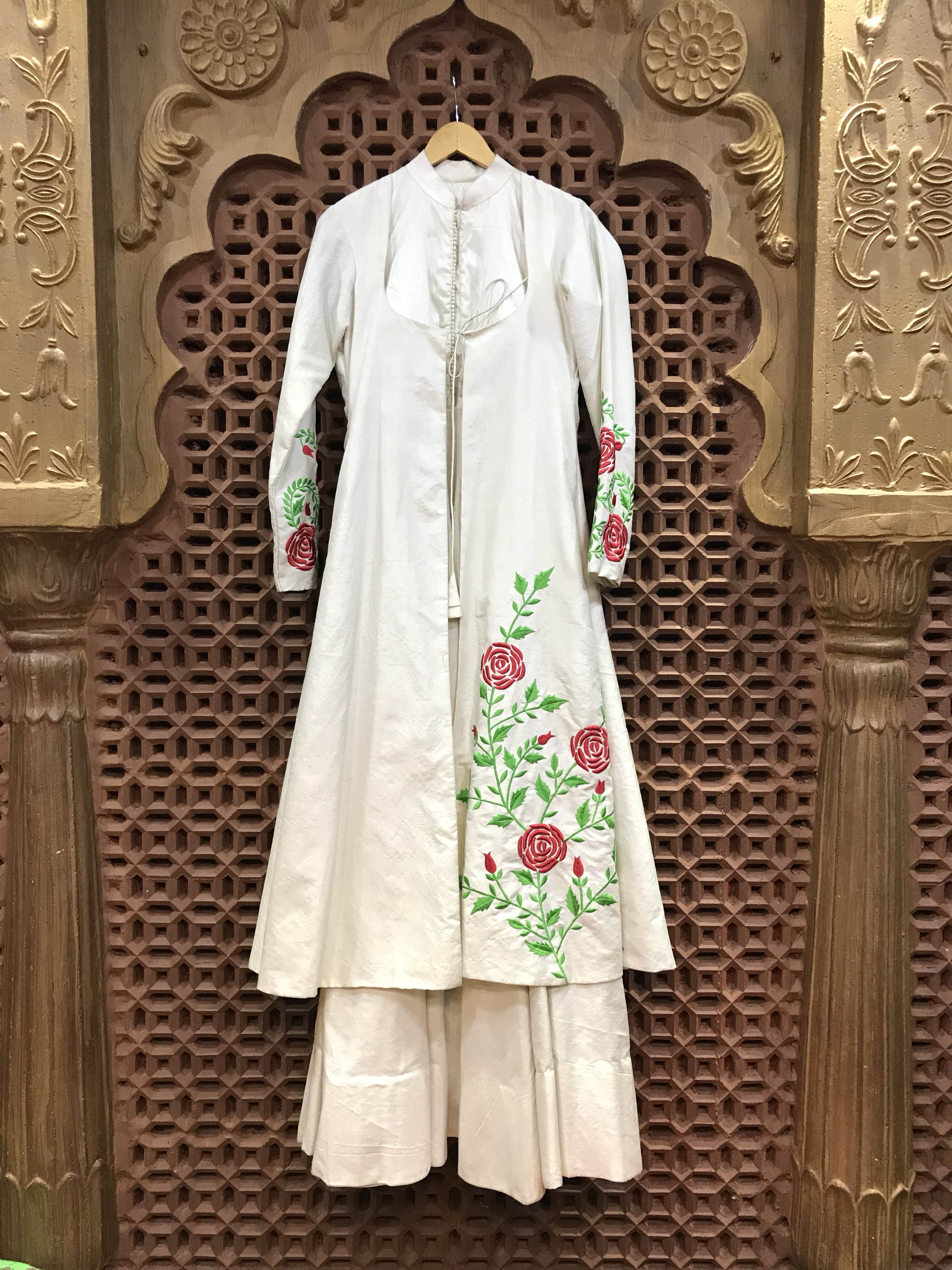 Designer Wear Cum Traditional Ethnic Wear This beautiful handcrafted gown cum indowestern designer off white traditional jacket pattern thread work all over the front jacket flap with sleeves and back also crafted with beautiful thread work and a simple elegant flailed gown with a jacket pattern over it make it look more sophisticated designer cum Traditional Ethnic wear