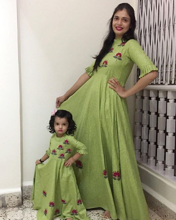 Mother Daughter Duo Designer Ethnic Gown this beautiful Mother Daughter Duo designer ethnic Handcrafted Thread fine shining work all over the gown cum kurti make a perfect duo dress for a loving family bonding between a mother and daughter .attractive colour with superb detailed hand work all over make it a prefect attire for a special occasion  .bright green colour with designer frilled sleeves with elbow length make It look more beautiful .