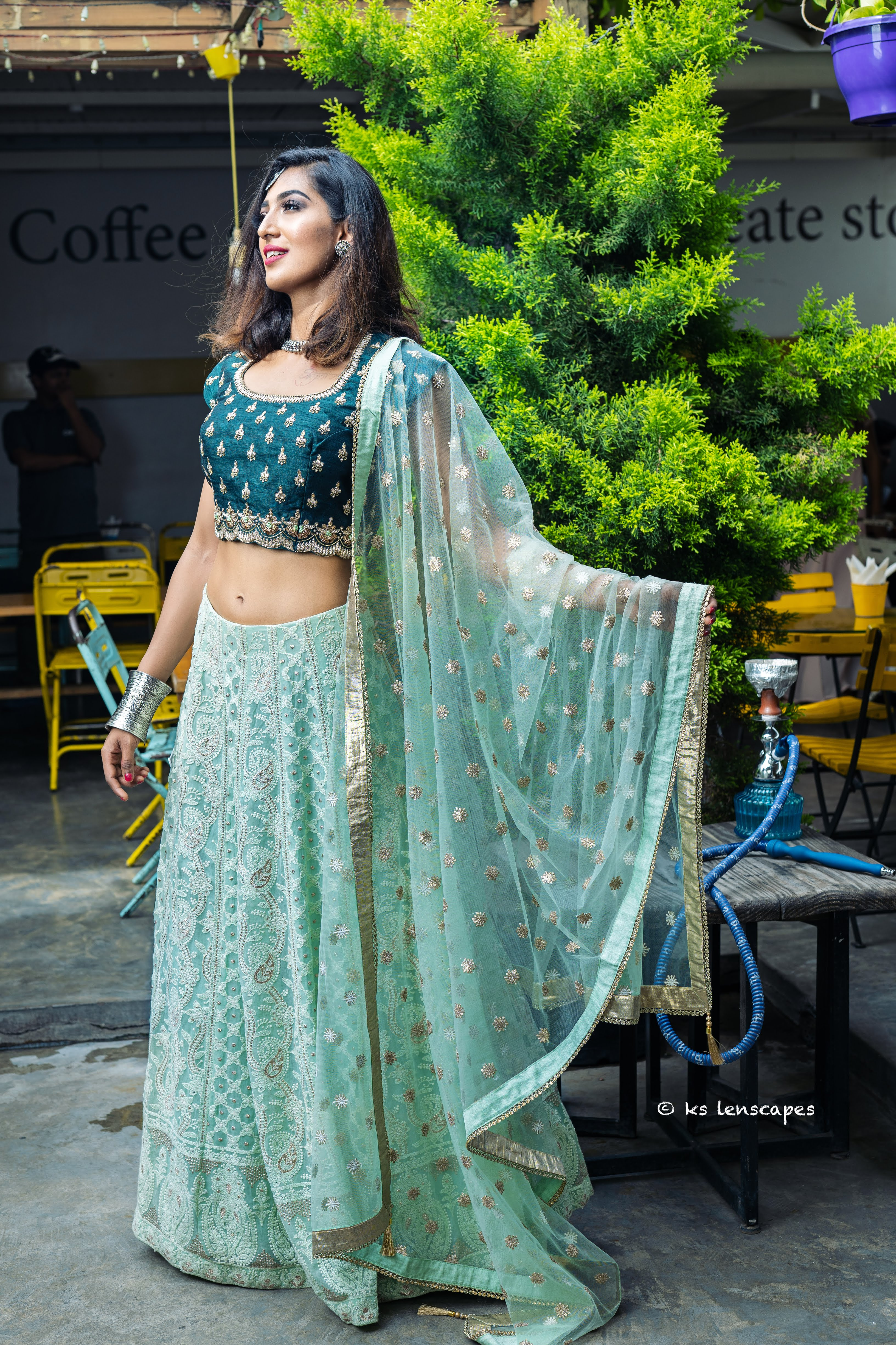 Featuring an ethereal Chikankari Emerald Green Lehenga, with translucent overlapping sequins on the blouse.